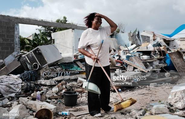 Flo Webber stands amongst the debris of her home on the nearly destroyed island of Barbuda on December 8, 2017 in Cordington, Barbuda. Barbuda, which...
