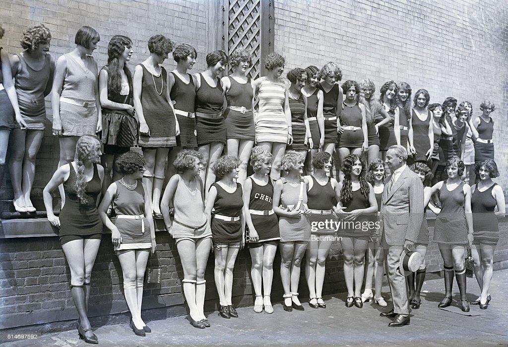 Florenz Ziegfeld Looking at Beauty Contestants in Swimwear : News Photo
