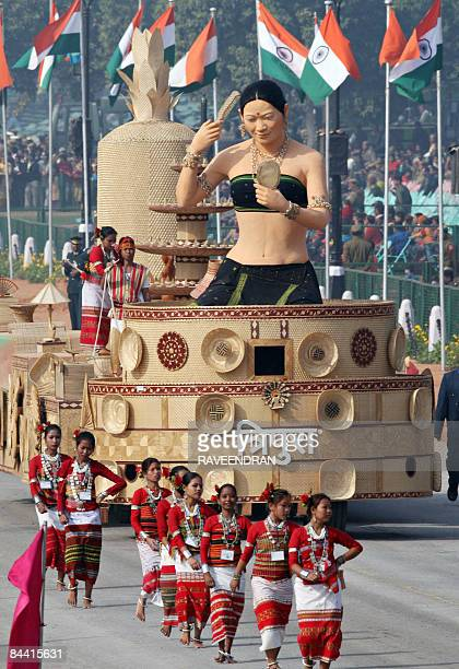 A float carrying a tableau from Tripura state rolls past during the final full dress rehearsal for the Indian Republic Day parade in New Delhi on...