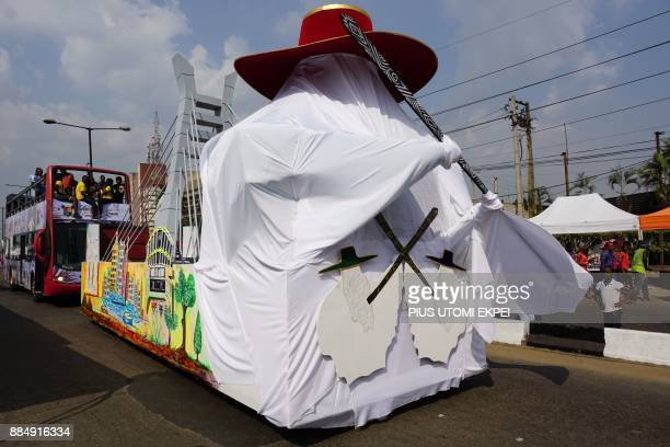 A float depicting a dancer of the Eyo masquerades festival is paraded during the Lagos Street Carnival on December 3 in Lagos Commercial activities...
