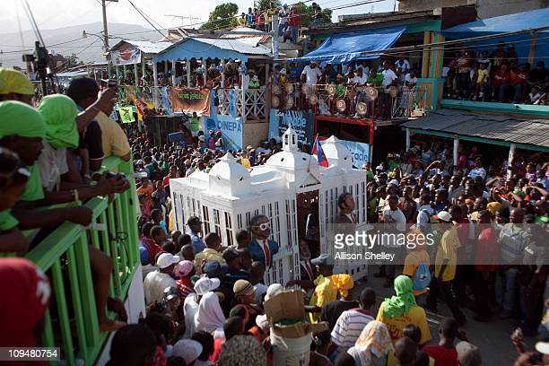 A float depicting the Haitian presidential palace and papier mache figures of former Haitian president JeanBertrand Aristide Haitian president Rene...
