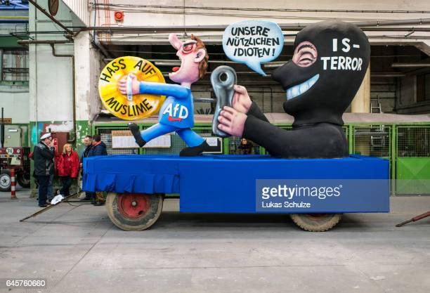 A float featuring a terrorist of IS and a member of german party AfD prior to the annual Rose Monday parade on February 27 2017 in Dusseldorf Germany...