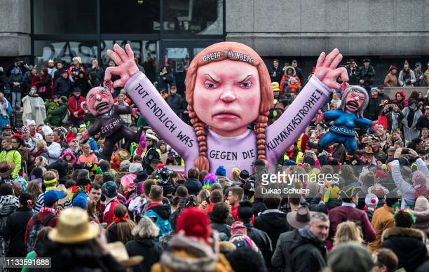 A float featuring an effigy of climate activist Greta Thunberg makes its way through the annual Rose Monday Carnival parade on March 4 2019 in...