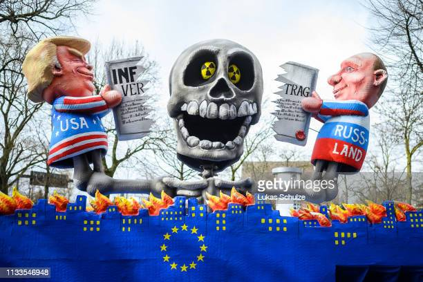 A float featuring an effigy of US president Donald Trump and Russian president Wladimir Putin is seen prior to the annual Rose Monday Carnival parade...