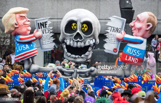 A float featuring an effigy of US president Donald Trump and Russian president Wladimir Putin makes its way through the annual Rose Monday Carnival...