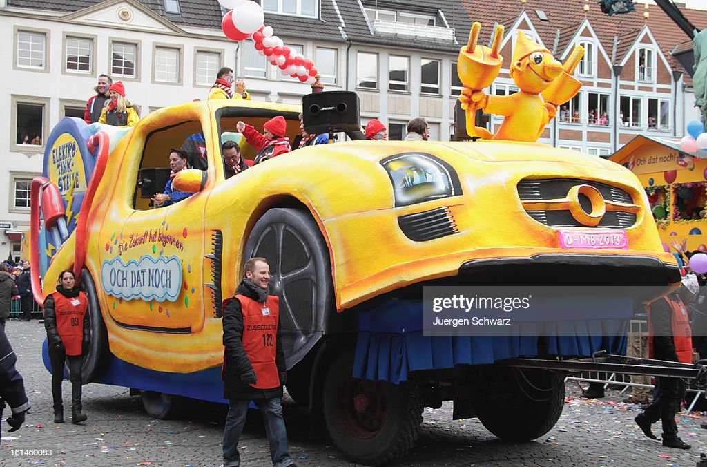 A float featuring an electric car makes its way along the route at Rose Monday carnival parade on February 11, 2013 in Dusseldorf, Germany. Rose Monday is the highpoint of the annual carnival season in the region between Mainz, Cologne and Dusseldorf, where the carnival has been an annual tradition since 1823 and celebrates free-spirited merrymaking before the beginning of Lent.