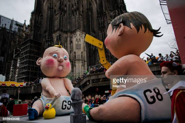 A float featuring 'G8 and G9' drives in the annual Rose Monday parade next to the Cathedral on February 27 2017 in Cologne Germany Political satire...