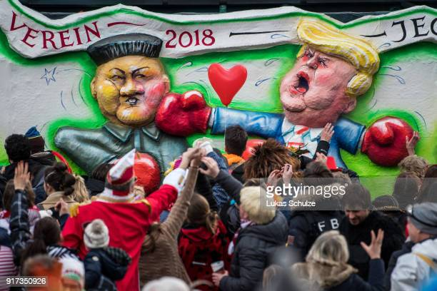 A float featuring Kim Jong Un and US President Donald Trump is seen during the annual Rose Monday parade on February 12 2018 in Dusseldorf Germany...