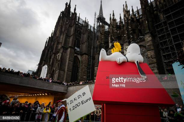 A float featuring Snoopy and higher rents drives in the annual Rose Monday parade next to the Cathedral on February 27 2017 in Cologne Germany...