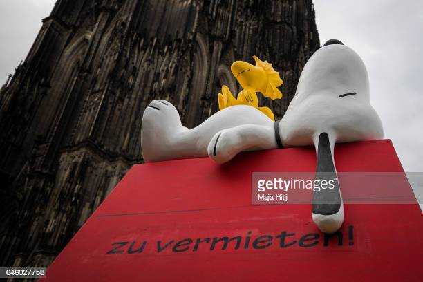 A float featuring Snoopy drives in the annual Rose Monday parade next to the Cathedral on February 27 2017 in Cologne Germany Political satire is a...
