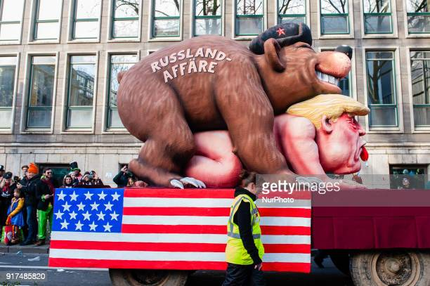 A float featuring US President Donald Trump and a russian bear is seen during the annual Rose Monday parade on February 12 2018 in Dusseldorf Germany...