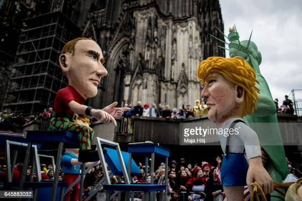 A float featuring US President Donald Trump and Russian President Vladimir Putin drives in the annual Rose Monday parade next to the Cathedral on...