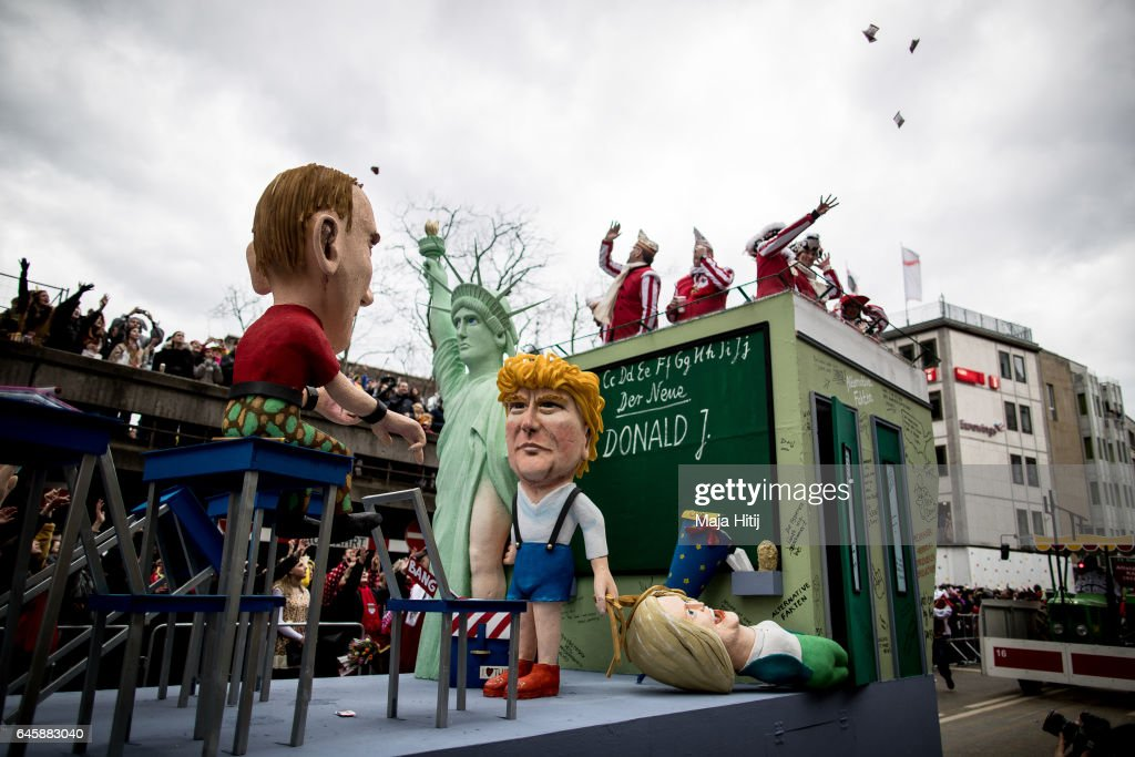 A float featuring U.S. President Donald Trump and Russian President Vladimir Putin drives in the annual Rose Monday parade on February 27, 2017 in Cologne, Germany. Political satire is a traditional cornerstone of the annual parades and the ascension of Donald Trump to the U.S. presidency, the rise of the populist far-right across Europe and the upcoming national elections in Germany provided rich fodder for float designers this year.