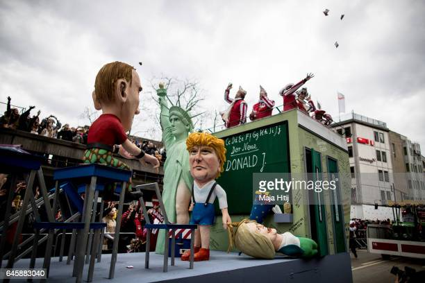 A float featuring US President Donald Trump and Russian President Vladimir Putin drives in the annual Rose Monday parade on February 27 2017 in...