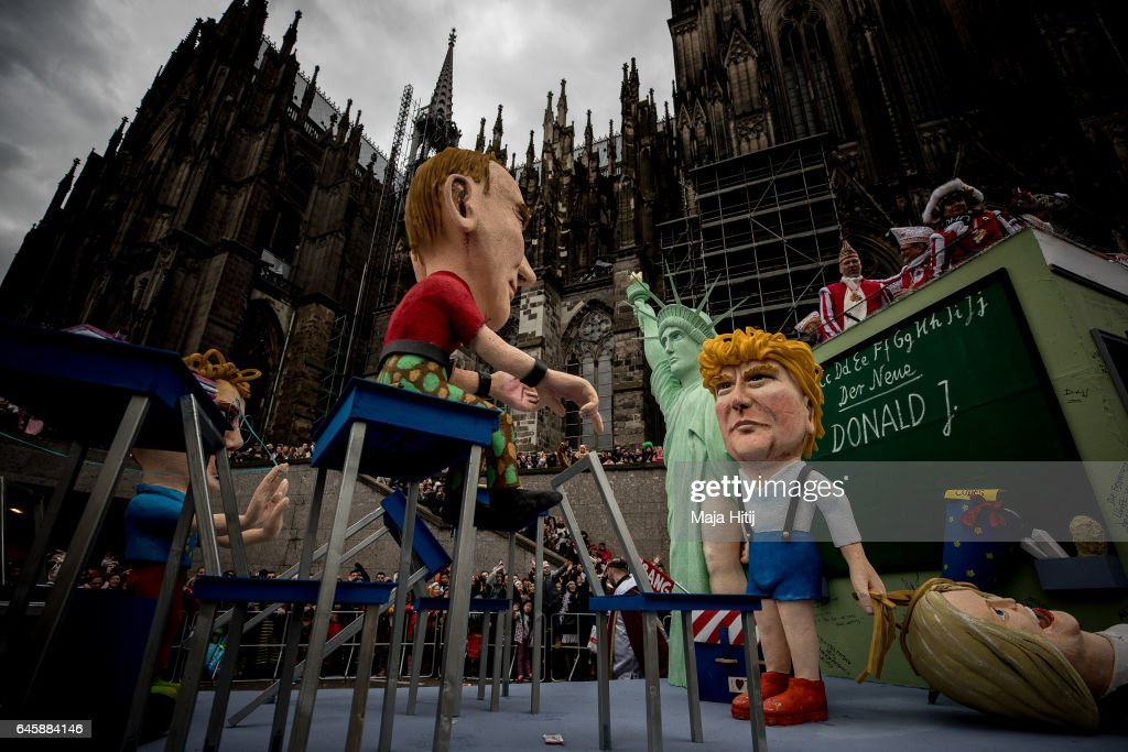 A float featuring U.S. President Donald Trump and Russian President Vladimir Putin drives in the annual Rose Monday parade next to the Cathedral on February 27, 2017 in Cologne, Germany. Political satire is a traditional cornerstone of the annual parades and the ascension of Donald Trump to the U.S. presidency, the rise of the populist far-right across Europe and the upcoming national elections in Germany provided rich fodder for float designers this year.