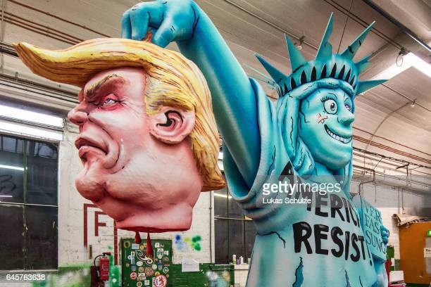 A float featuring US President Donald Trump and the Statue of Liberty prior to the annual Rose Monday parade on February 27 2017 in Dusseldorf...