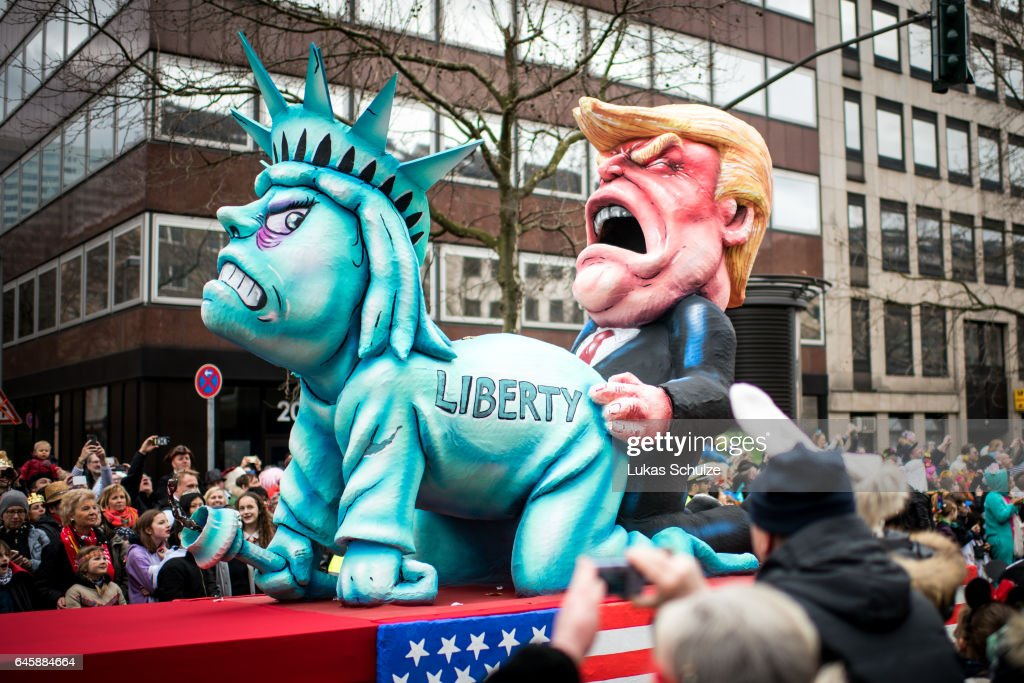 A float featuring U.S. President Donald Trump and the Statue of Liberty drives in the annual Rose Monday parade on February 27, 2017 in Dusseldorf, Germany. Political satire is a traditional cornerstone of the annual parades and the ascension of Trump to the U.S. presidency, the rise of the populist far-right across Europe and the upcoming national elections in Germany provided rich fodder for float designers this year.