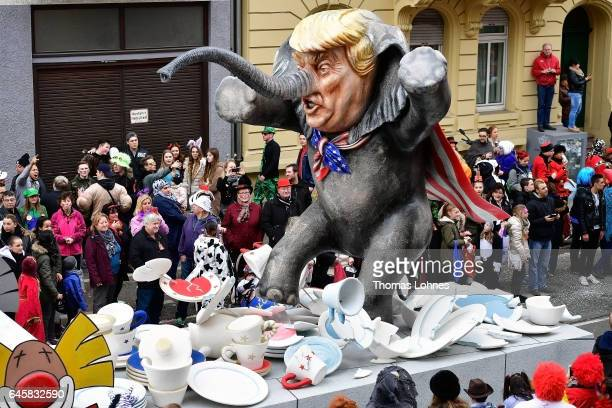 A float featuring US President Donald Trump drives in the annual Rose Monday parade on February 27 2017 in Mainz Germany Political satire is a...