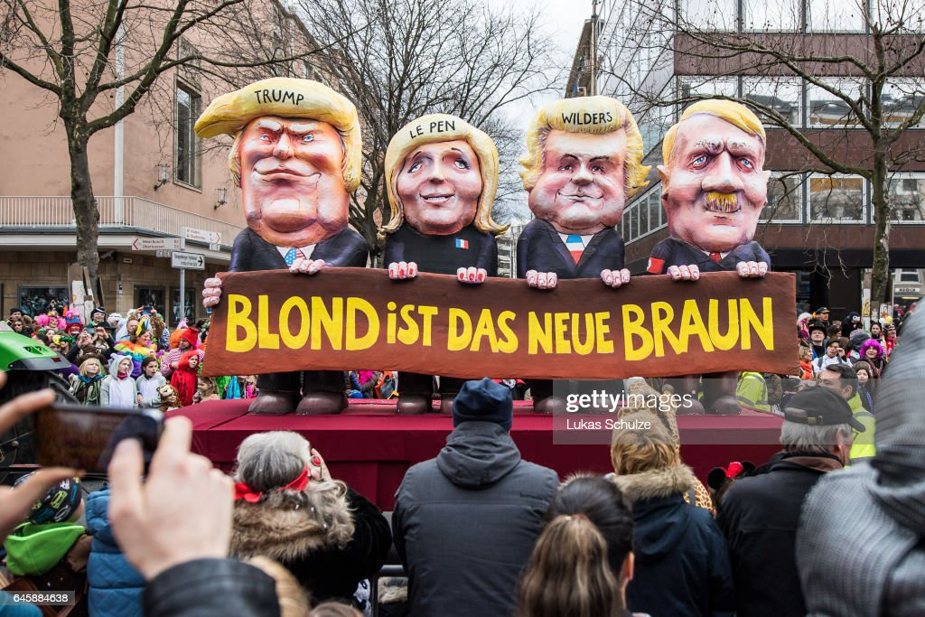 A float featuring U.S. President Donald Trump (L-R), Marine Le Pen of Front National, Geert Wilders of Partij voor de Vrijheid and Adolf Hitler drives in the annual Rose Monday parade on February 27, 2017 in Dusseldorf, Germany. Political satire is a traditional cornerstone of the annual parades and the ascension of Trump to the U.S. presidency, the rise of the populist far-right across Europe and the upcoming national elections in Germany provided rich fodder for float designers this year.