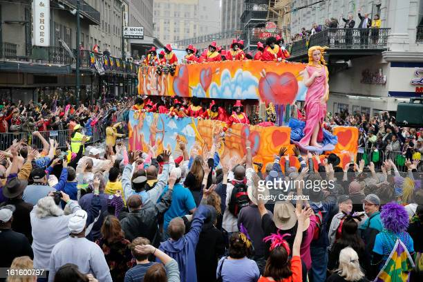 A float in the Krewe of Zulu parade turns on to Canal Street to large crowds with out outstretched arms on Mardi Gras Day Fat Tuesday the traditional...