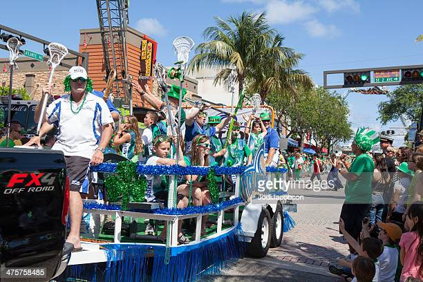 float in the st. patrick's day parade - delray beach stock photos and pictures