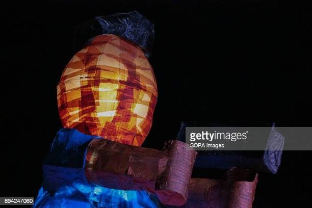 OVAL QUEZON NCR PHILIPPINES A float of a policeman with a gun portraying a scene from the War on Drugs by the College of Social Sciences and...