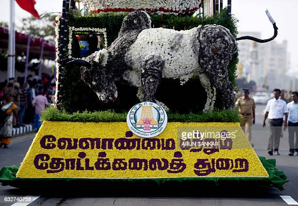 A float parades a model of Indian bull in support of the 'Jallikattu' bulltaming festival a ban on which has been overturned during a parade to mark...