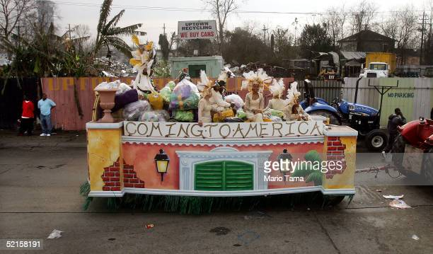 A float passes a junkyard at the start of the Zulu parade a primarily AfricanAmerican parade during Mardi Gras festivities February 8 2005 in New...