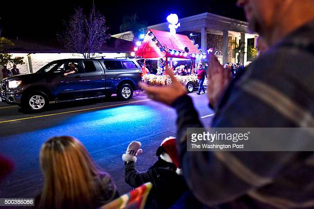 Float passes by spectators at the Redlands Christmas Parade Saturday night. 2015 Redlands Christmas Parade Saturday Dec. 5, 2015 in Redlands, CA.