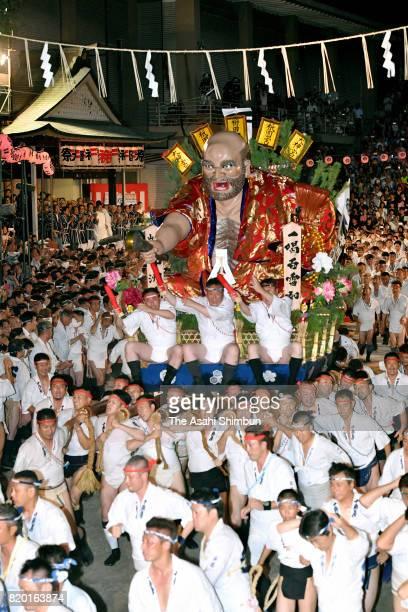 A float ruhses throught Seido street of Kushida Jinja Shrine during the 'Oiyama' part of the Hakata Gion Yamakasa on July 15 2017 in Fukuoka Japan...