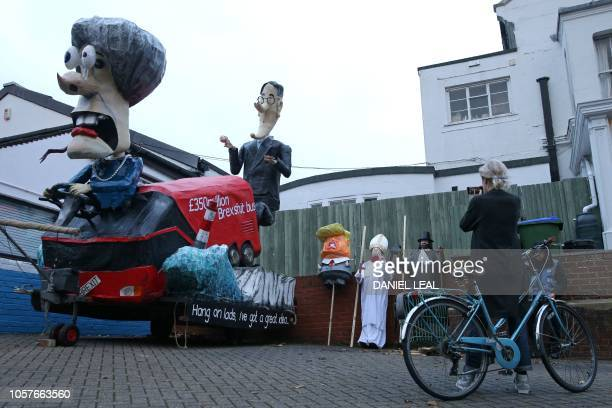 Float showing the Brexit Bus, driven by Britain's Prime Minister Theresa May and Jacob Rees-Mogg is prepared ahead of the parade in the streets of...