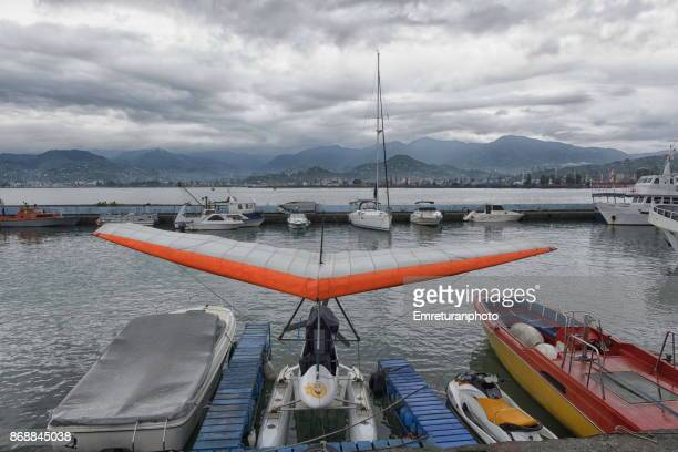 a float trike and boats in batumi marina on a rainy autumn day. - emreturanphoto stock pictures, royalty-free photos & images