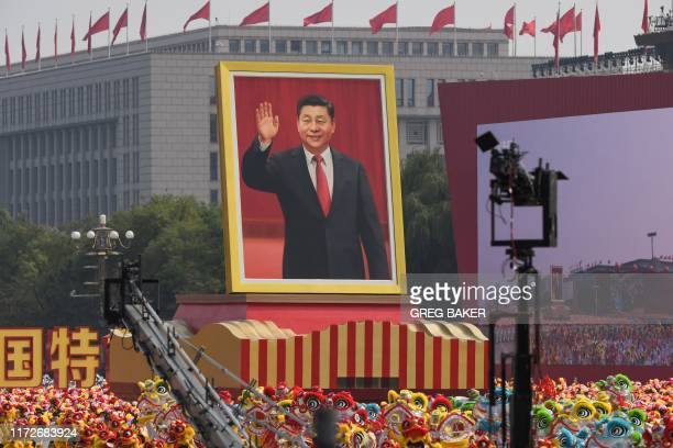 A float with a giant portrait of Chinese President Xi Jinping passes by Tiananmen Square during the National Day parade in Tiananmen Square in...