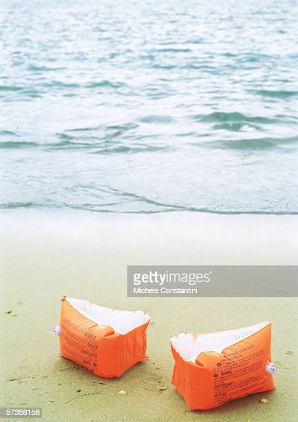 floaties on beach - armband stock pictures, royalty-free photos & images