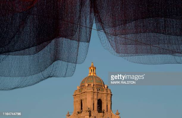 TOPSHOT A floating aerial sculpture titled 178 by the artist Janet Echelman hangs over a the City Hall in Beverly Hills California on August 28 2019...