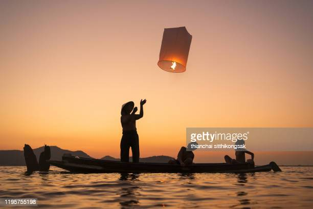 floating asian lanterns for lucky to family - cultures stock pictures, royalty-free photos & images