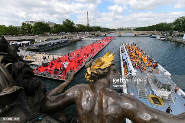 Floating athletics track install on the Seine River for the Olympics days for Paris 2024 Summer Olympics Games candidacy in Paris France on June 24...
