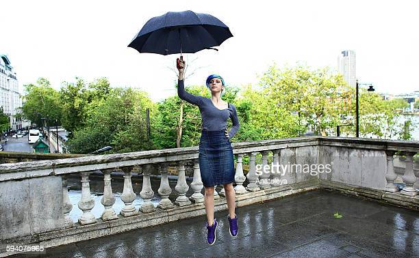 floating away with an umbrella - anatoleya stock pictures, royalty-free photos & images