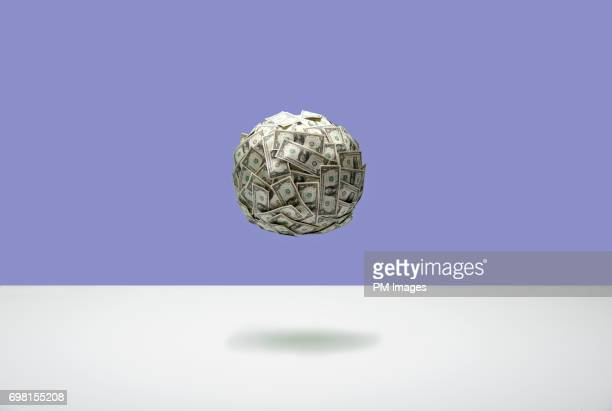 floating ball of money - prosperity stock photos and pictures