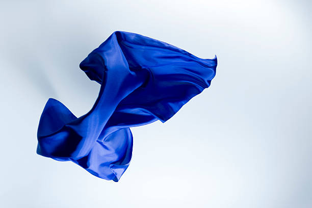 Floating blue silk on a bright background