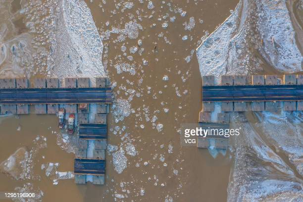 Floating bridge is demolished as ice floes appear on the Yellow River on January 7, 2021 in Binzhou, Shandong Province of China.