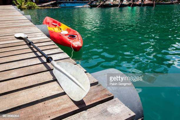 floating canoe or kayak in ratchaprapha dam, thailand - lagoon stock pictures, royalty-free photos & images