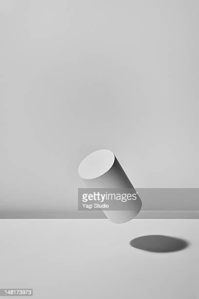 floating column  with white background - cylinder stock pictures, royalty-free photos & images