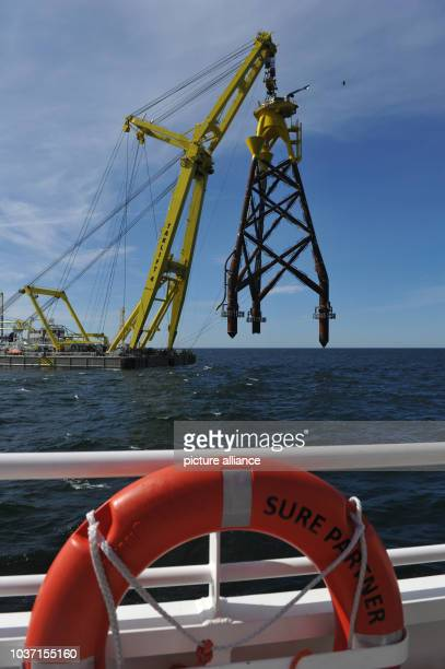 Floating crane 'Taklift 4' lifts a socalled 'Jackets' construction foundation for the offshore wind park 'EnBW Baltic 2' on location at the...
