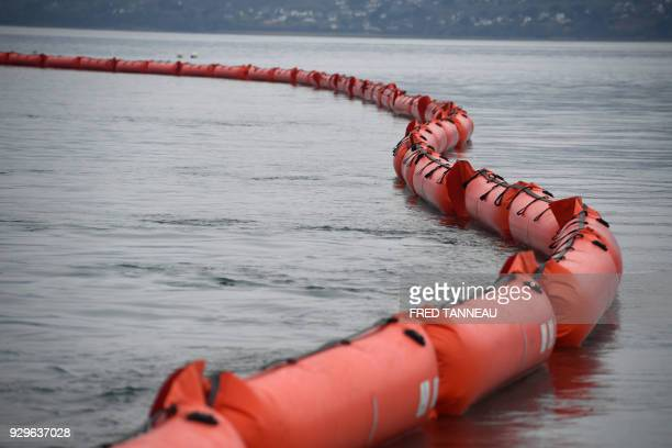 A floating dam is unwinded by the crew of the antipollution vessel Argonaute during a drill on March 6 2018 in Brest western France On March 16 1978...