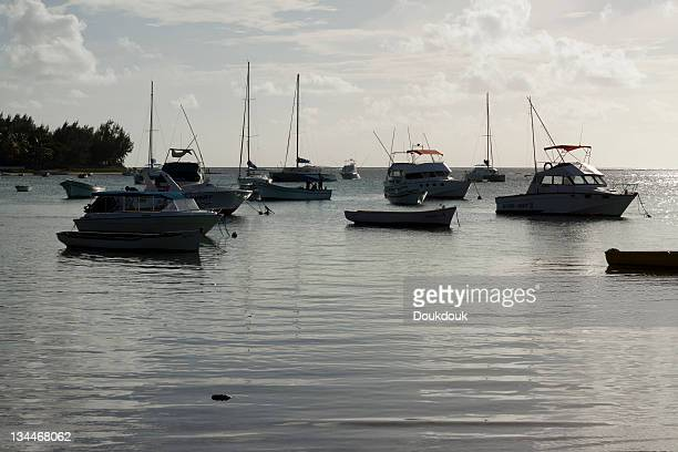 Floating dinghies at sunset in Bain Aux Boeuf, Mauritius, Africa