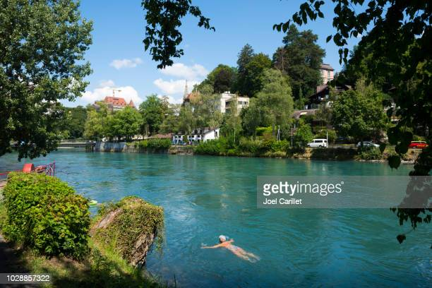 floating down the aare river in bern, switzerland - bern stock photos and pictures