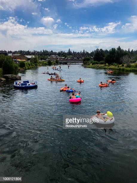 floating down the deschutes river in bend, oregon - bend oregon stock photos and pictures