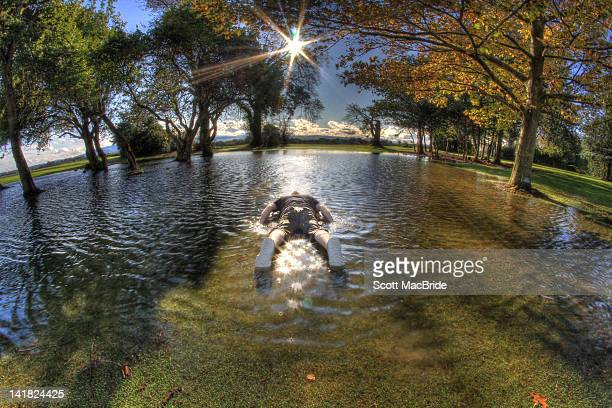 floating face down - scott macbride stock pictures, royalty-free photos & images