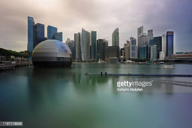 Floating glass orb, allegedly to be the new Apple flagship store at Marina Bay Sands is seen with the Central Business District in the background on...